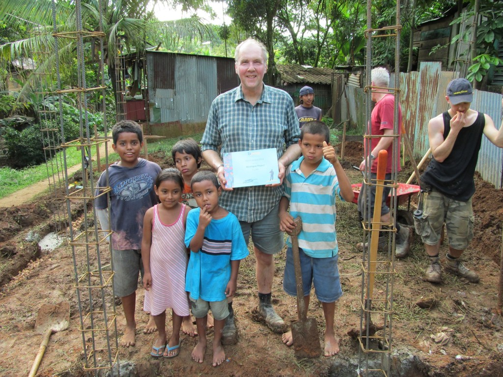 John Booth in Nicaragua with his Merit Award