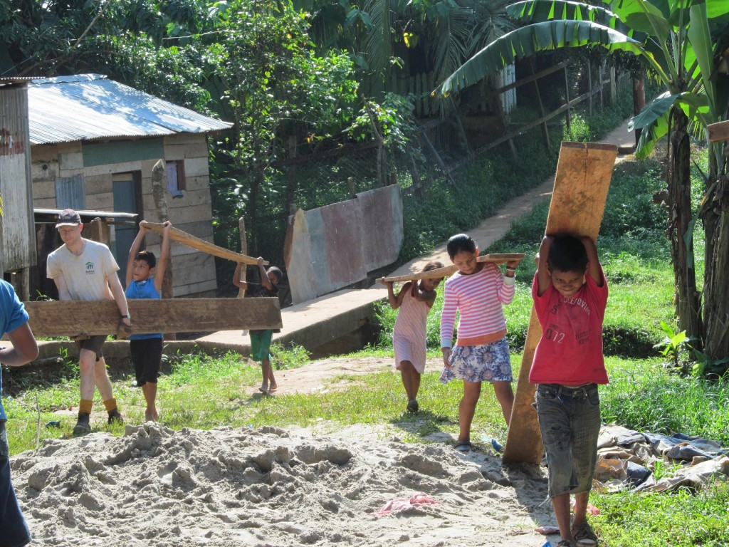 Local kids carrying timber - boy in red called 'Rambo' small
